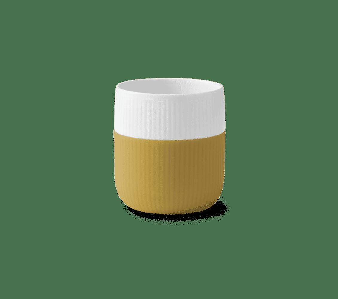 taza amarilla de porcelana